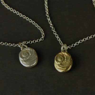 Silver and brass shiva eye necklaces 2